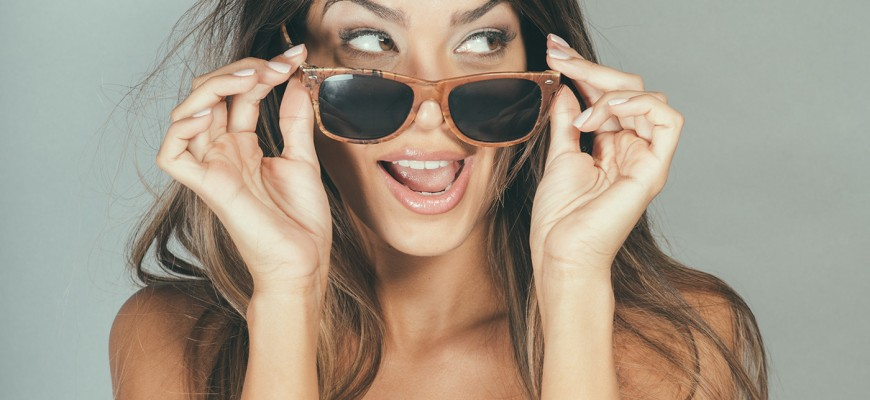 mw-Playful-Girl-Holding-Sunglasses,-Lifestyle-Fun